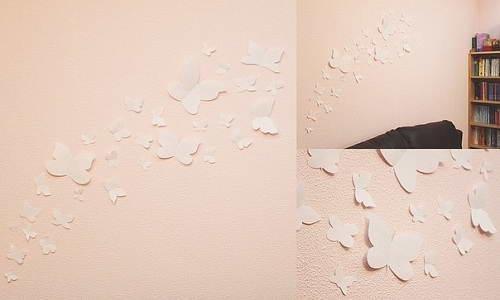 Оформление стен с помощью бумажных бабочек