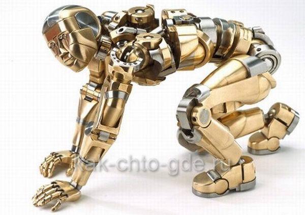 Металлический человек  из стали и бронзы в движениях и пластике